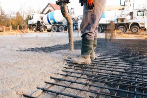 Commercial Concrete worker laying a foundation for a business in Mililani